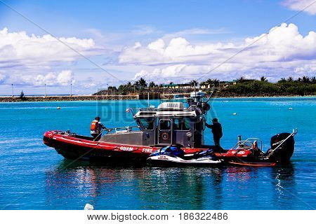 Tamon Guam Island October 31 2015: Island of Guam Fire Rescue boat in the Tamon harbor on October 31th 2015