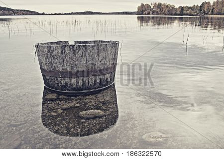 Barrell lying in the water by the beach