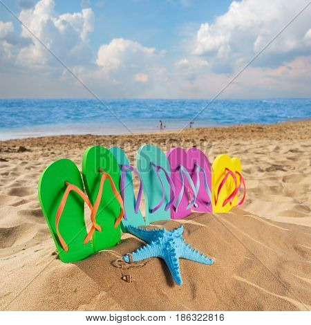 Summer beach fun - set of family sandals in beach sand