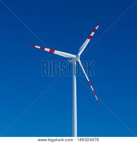 Windmill with clear blue sky, windmill turbine detail