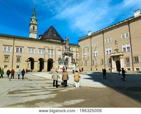 Salzburg, Austria - May 01, 2017: Classic view of famous Maria Immaculata sculpture at Domplatz square on a sunny day with blue sky in summer, Salzburg, Austria on May 01, 2017