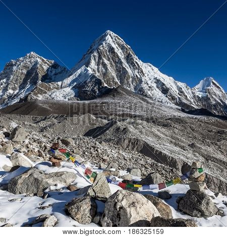 Buddhist Prayer Flags On Mountain Cairns On Everest Base Camp Route In Himalayas, Nepal. Waving Budd