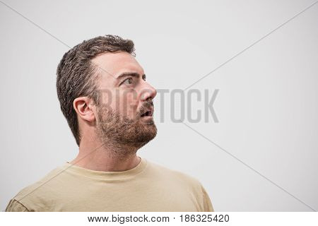 Head Of Surprised Man Portrait On Gray Background
