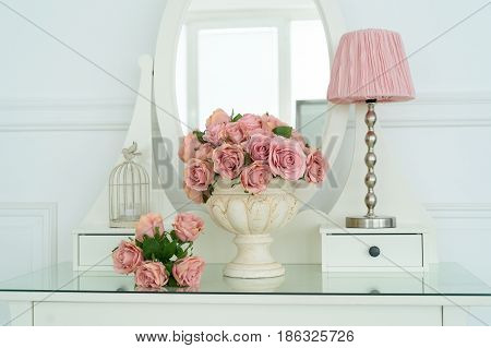 Bouquet Of Pink Rores In Vase And Pink Lamp On White Boudoir Table With Oval Mirror. Detail Of The I