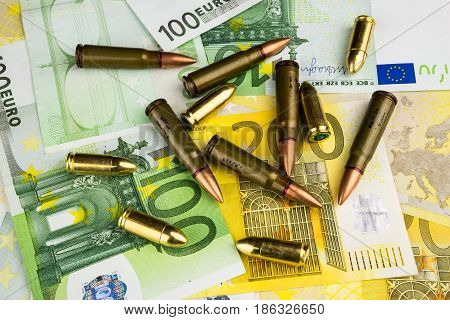 Banknotes and bullets, money and bullets detail