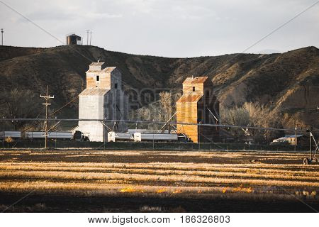Grainery Buildings And Burning Crops
