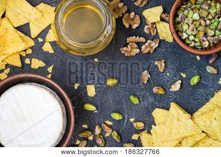 Ingredients Layout For Baking Soft Cheese Brie With Walnuts, Pistachios And Honey. Snack Concept Wit