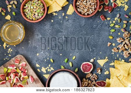 Ingredients Layout For Baking Soft Cheese Brie With Figs, Walnuts, Pistachios And Honey. Snack Conce