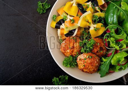 Farfalle Pasta Durum Wheat With Baked Meatballs Of Chicken Fillet  In Tomato Sauce And Salad In  Bow