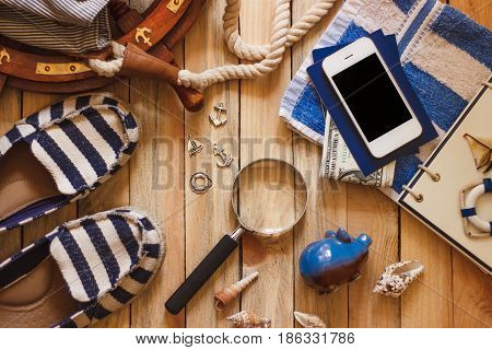 Striped Slippers, Towel, Piggy Bank, Phone And Maritime Decorations