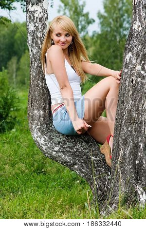 Pretty Girl Sit On Birch In A Park.