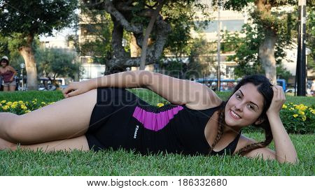 Girl Teenager And Fitness Laying on Grass