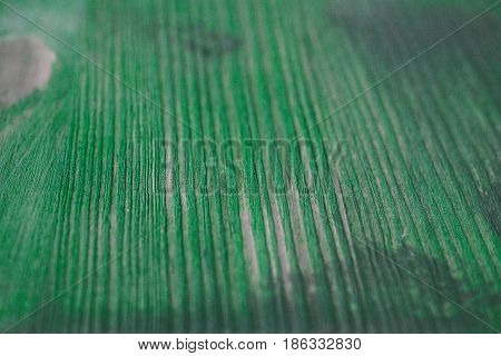 Green wood texture. Green wood background. Close up view of green wood texture and background. Abstract background and texture for designers. Rustic table. Texture of handmade green table.