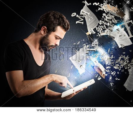 Man reading books and documents with an e-reader