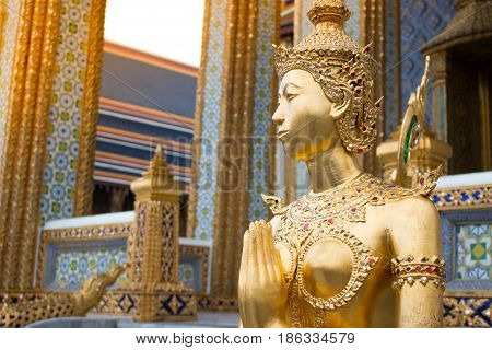 Beautiful Ki-nara Angel Stand Front Of Pagoda Temple In Bangkok As A Tourist Destination. Thai Angel