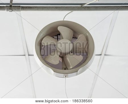 White plastic ventilation above the door of the urban office.