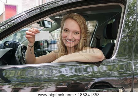 Smiling Proud Young Woman Displaying Her Licence