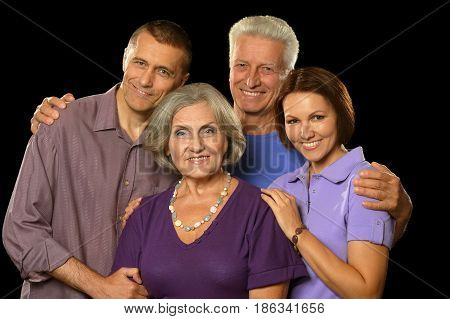 Portrait of happy parents with grown-up children