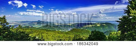 Panoramic view of the summer landscape of the Czech Middle Mountains/Czech Republic/