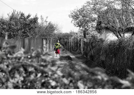 Elderly woman walks in the winter on the streetan elderly woman is walking