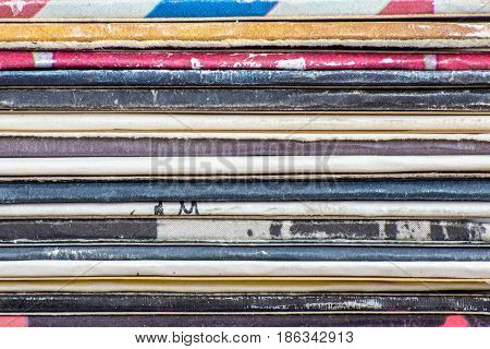 Close-up of old vinyl LP records stack bacground