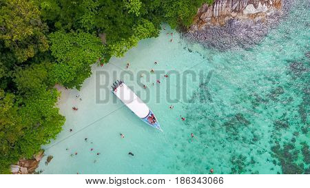 Aerial view over group of long tail boats with beautiful sea and beachTop view from drone Koh Lipe island SatunThailand.