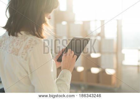 female hands holding tablet pc, typing, using touchscreen and wi-fi internet.