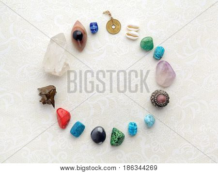 Composition of esoteric objects, used for healing and fortune-telling on light background
