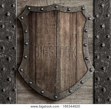 wood shield on medieval castle gate 3d illustration