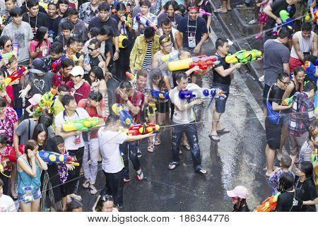 Bangkok Thailand - April 13 2017 : People celebrating the Songkran festival or Thai New Year's festival on Silom street in Bangkok Thailand.