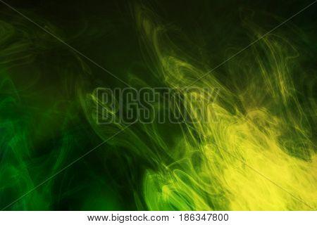 Green and yellow smoke background, close up