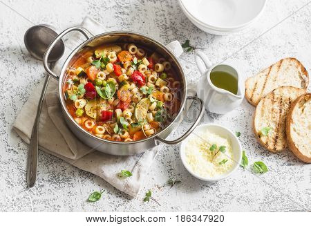 Vegetarian minestrone - delicious healthy mediterranean lunch. On a light table flat lay
