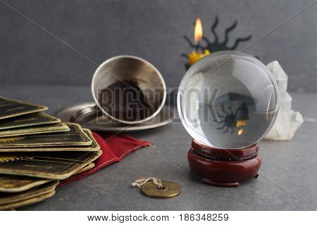 Composition of esoteric objects, used for healing and fortune-telling on dark background