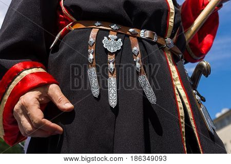 BERLIN - JUNE 11 2016: Russian Cossack shows decorative details of the uniforms. German-Russian festival devoted to the Independence Day of Russia. District Karlshorst East Berlin.