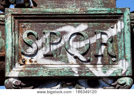SPQR metal inscription. SPQR is an acronym of a Latin phrase, Senatus Populusque Romanus The Roman Senate and People, referring to the government of the ancient Roman Republic.