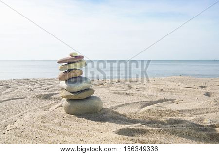 A beautiful small cairn sculpture on the beach near Lake Michigan.