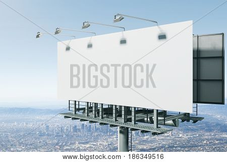 Side view of empty bill board on city background. Advertisement concept. 3D Rendering