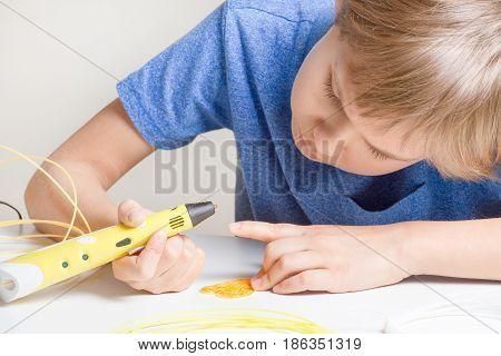Schoolboy with 3d pen. Creative, leisure, technology education concept