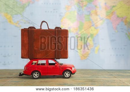 Retro car with suitcases on world map. Summer vacation concept