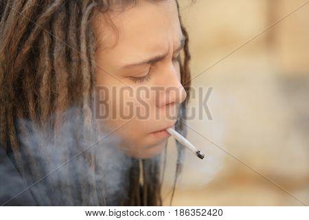 Young boy smoking weed, closeup