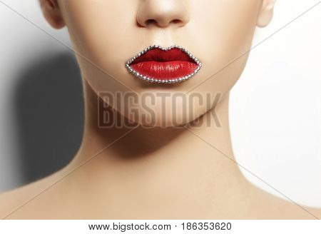 Beautiful young woman with creative makeup on white background, closeup
