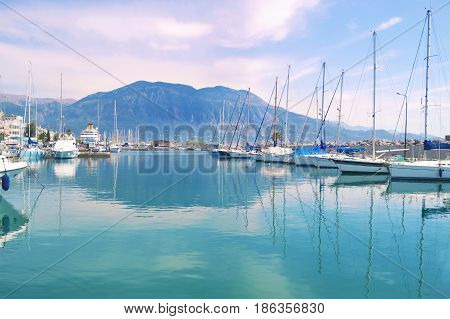 sailboats reflected on sea at Kalamata port Peloponnese Greece