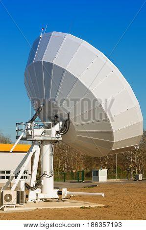 Satellite TV antenna in communication center . Large satellite dish