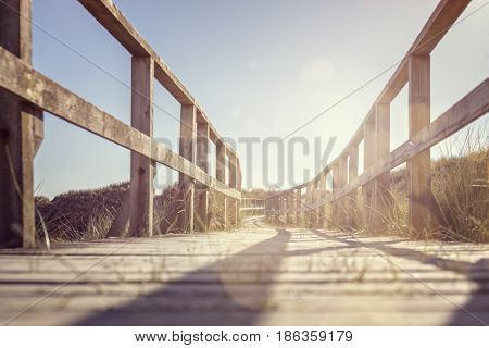 Boardwalk to the beach over sand dunes