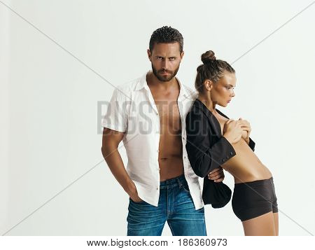 man or macho with muscular toso in open shirt cute girl or pretty woman with sexy fit belly and breast boobs covered by hands isolated on white. Couple in love. Sport fitness poster