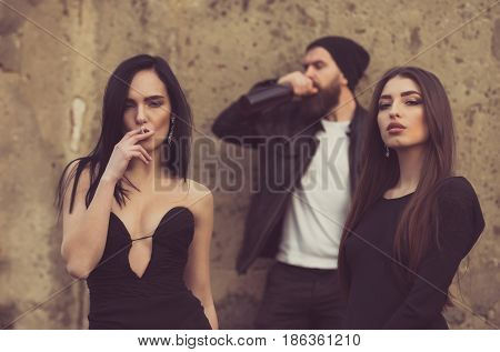 Girl Smoking Cigarette With Friends
