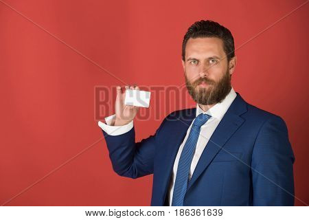 Confident Businessman With Silver Business Or Credit Card, Business Ethics