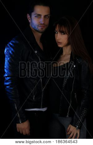 Attractive couple of vampires on a black background