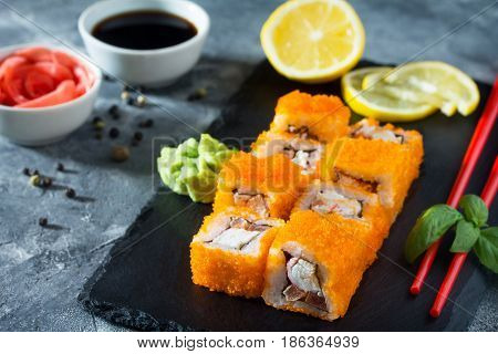 Roll Mr.krabs On A Black Slate Board - Red Tobiko Caviar, Mayonnaise, Crab Meat (imitation), Tomato,