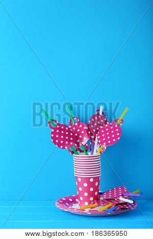 Paper Cups With Plates And Tubules On Blue Background